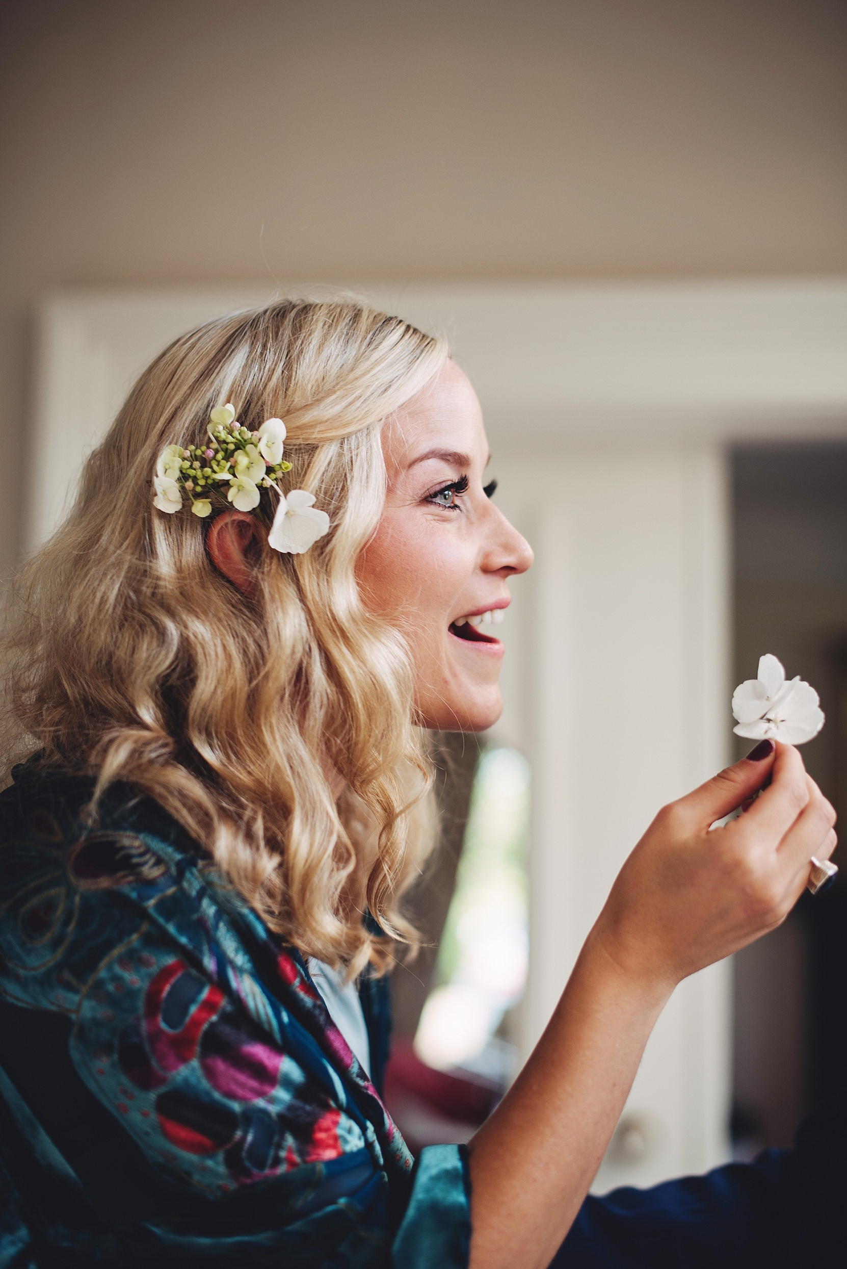 A bridesmaid with a flower at a wedding