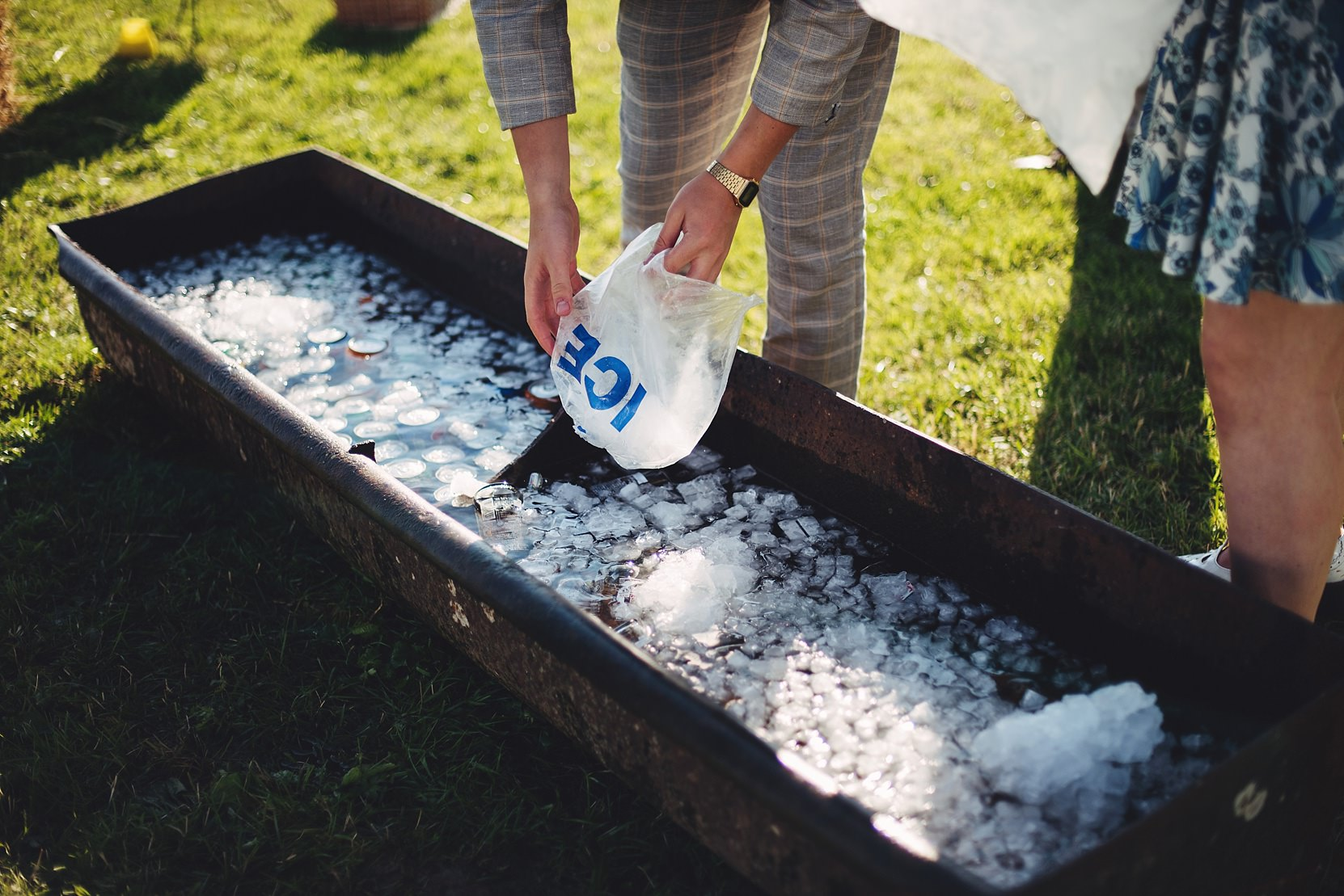 Filling a trough full of Ice for beers at a wedding
