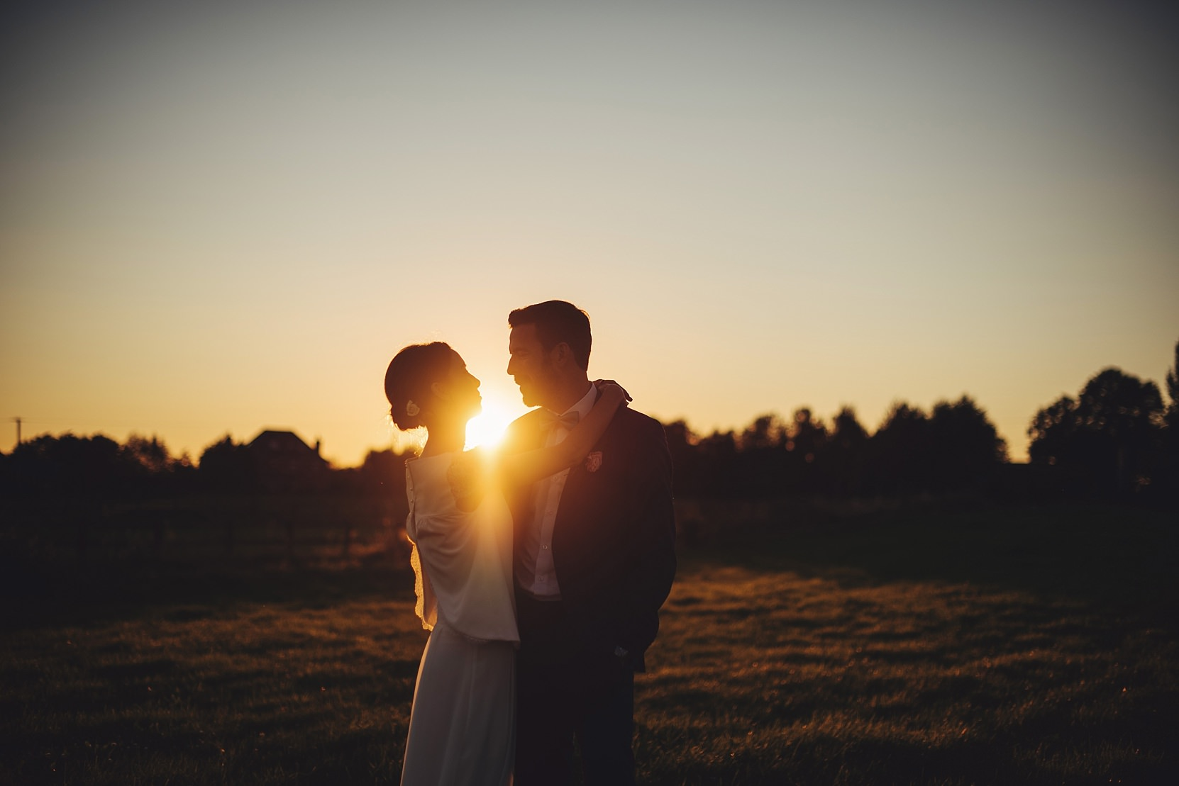 Bride and Groom at sunset in an open field