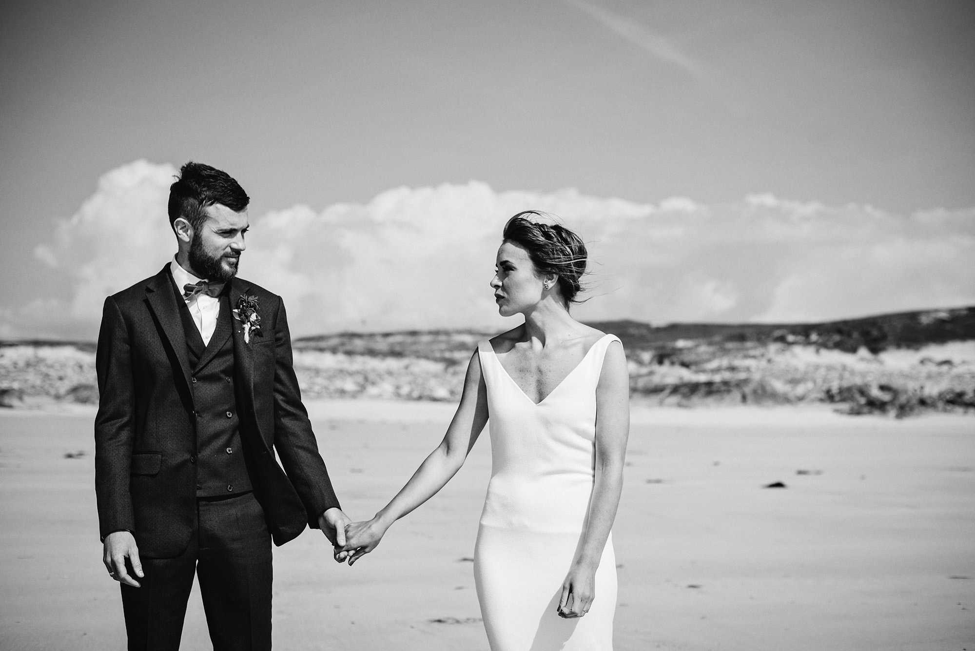 Bride and Groom on the beach in Clifden in Ireland, natural wedding photos.