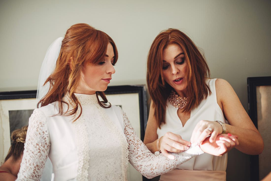 Bride and Bridesmaid getting prep