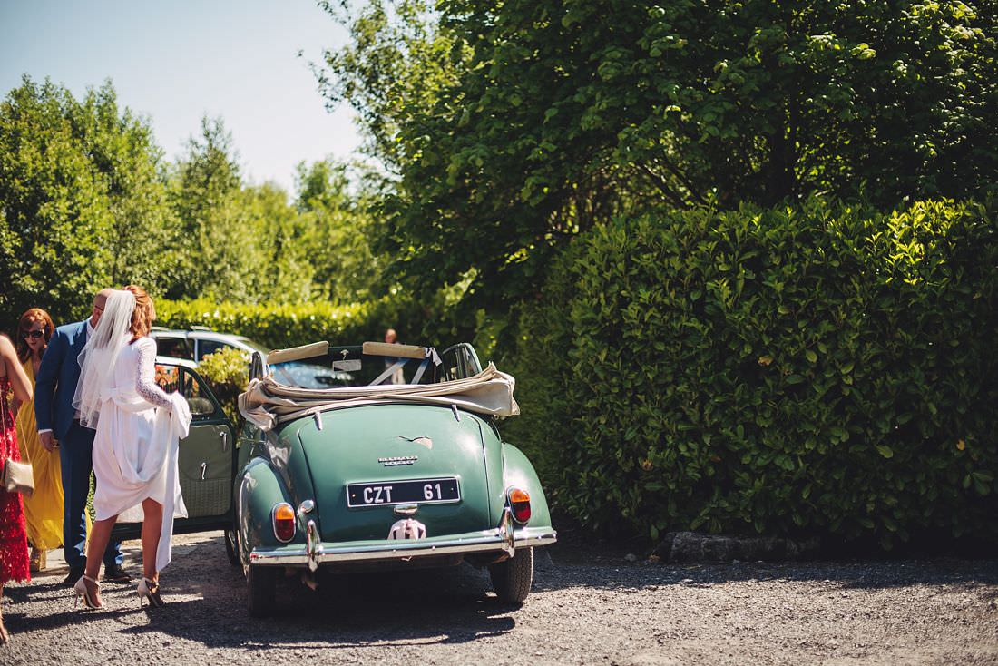 Bride in classic wedding car