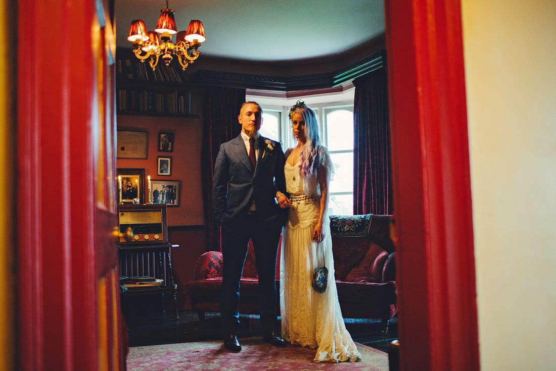 bride and groom pose for a photo in ballybeg house