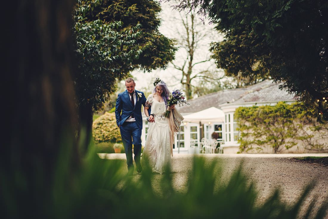 bride and groom walking into the marquee at ballybeg house wicklow