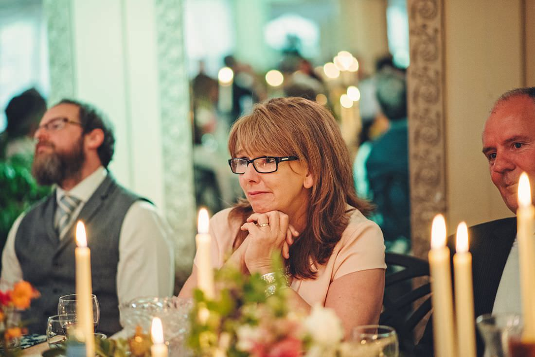 a lady watching speeches at a wedding