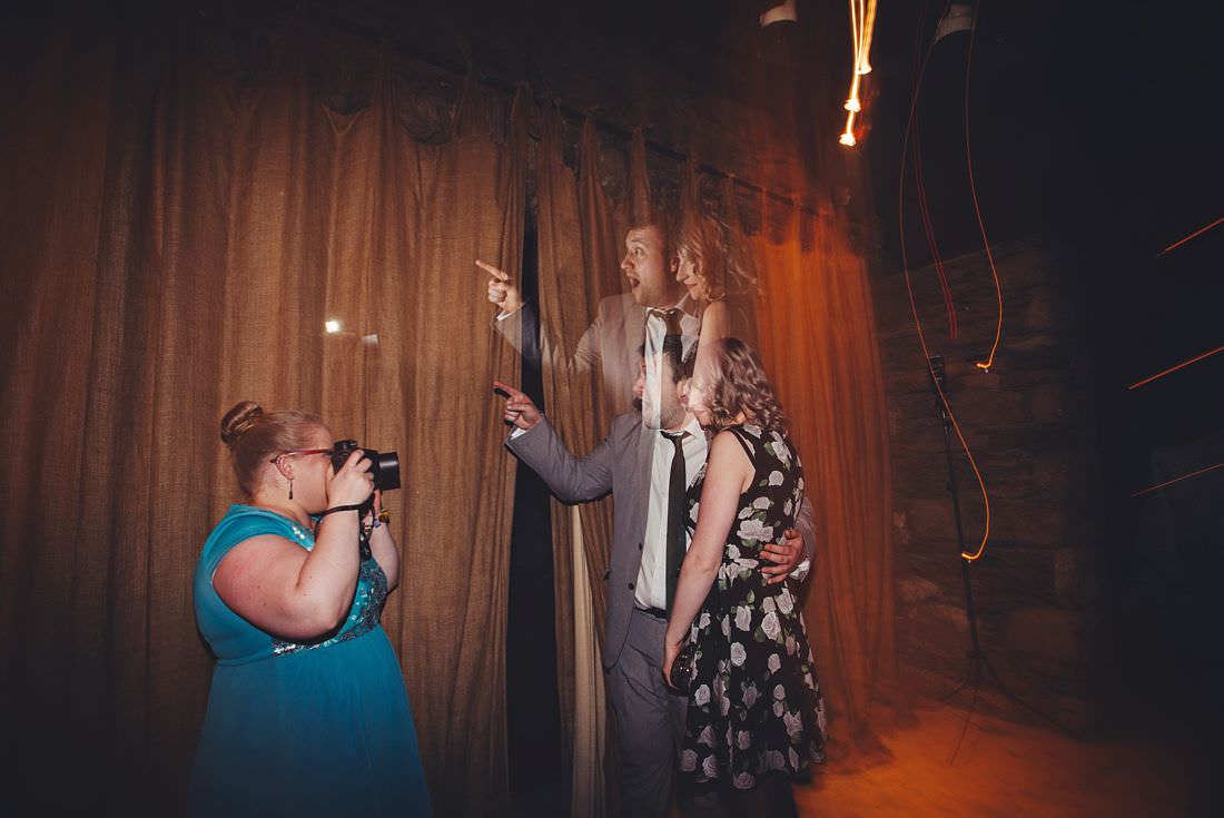 someone having their picture taken at a wedding