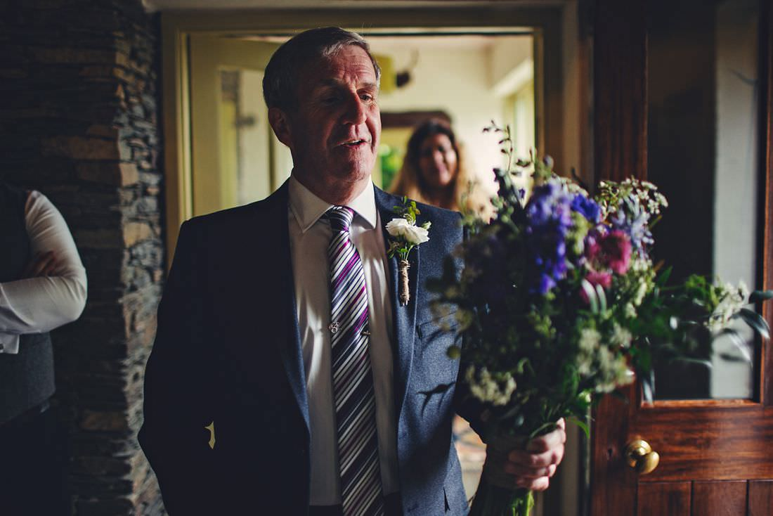 Dad giving the bride her flowers