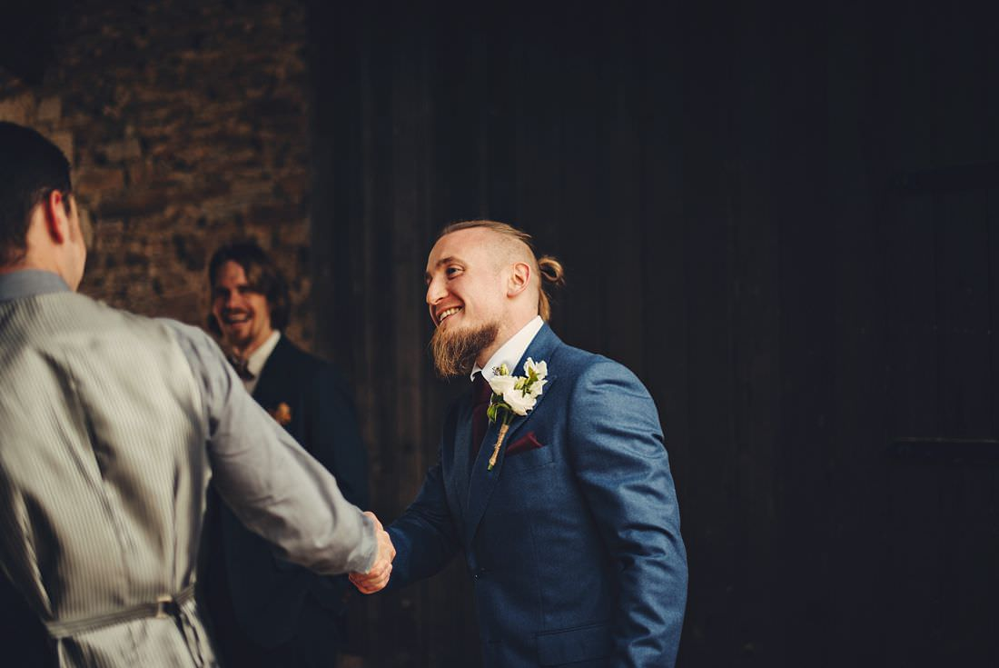 groom greeting guests at a wedding