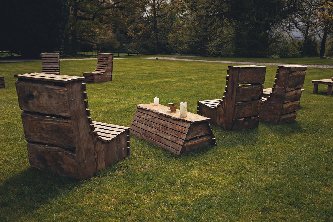 some wooden chairs on a lawn
