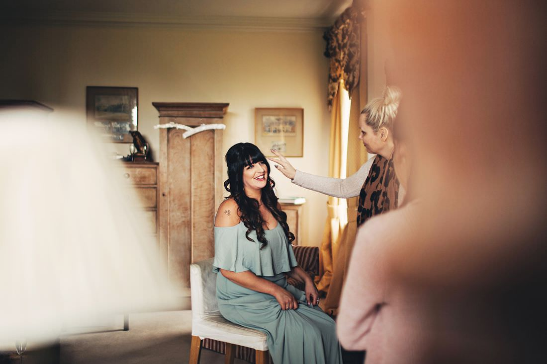 a bridesmaid getting her touch ups done