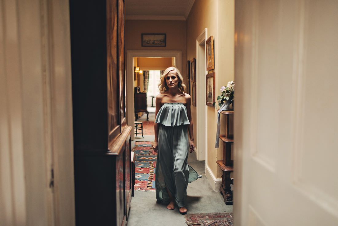 a bridesmaid walking down a hallway