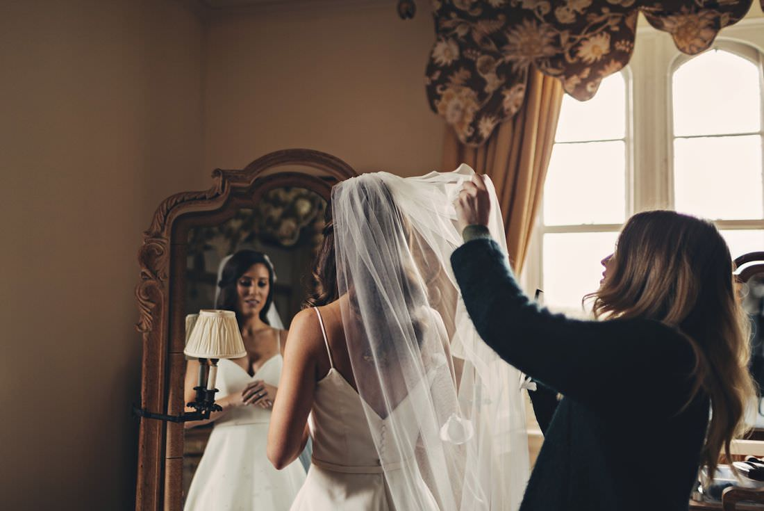 a bride getting her veil fixed