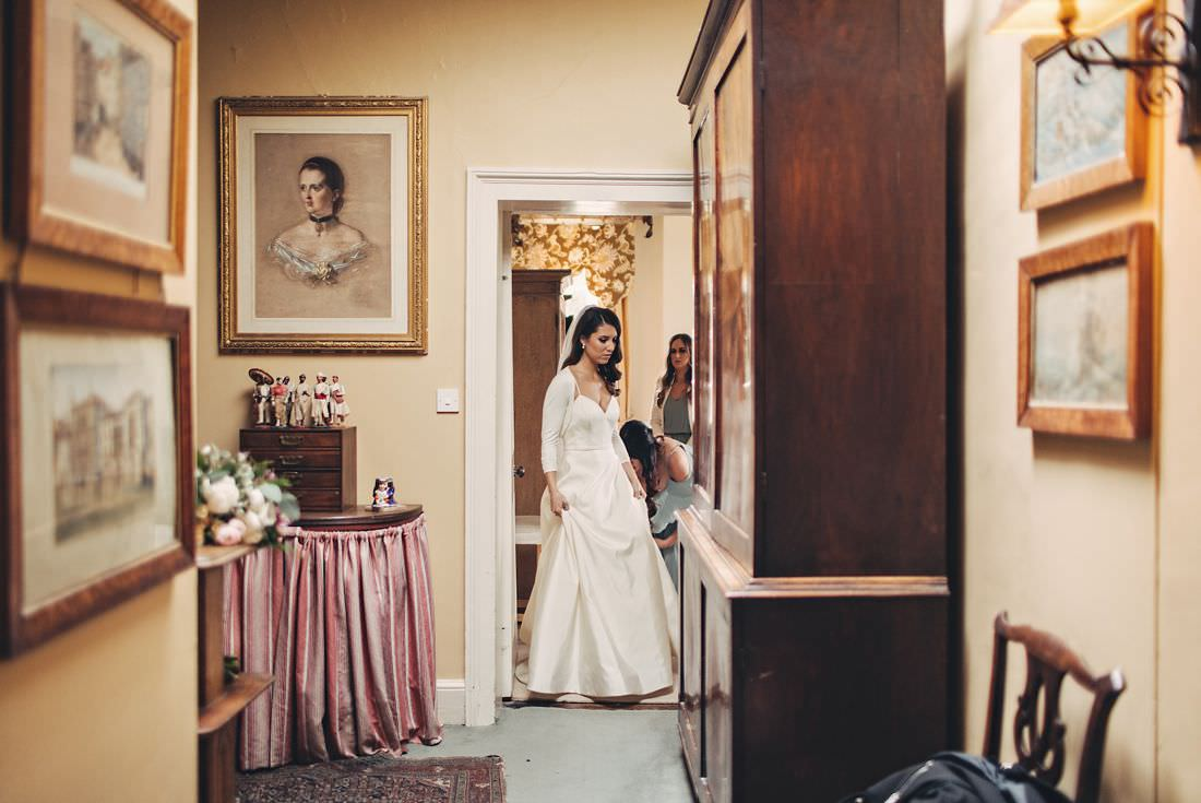 bride walking through a doorway