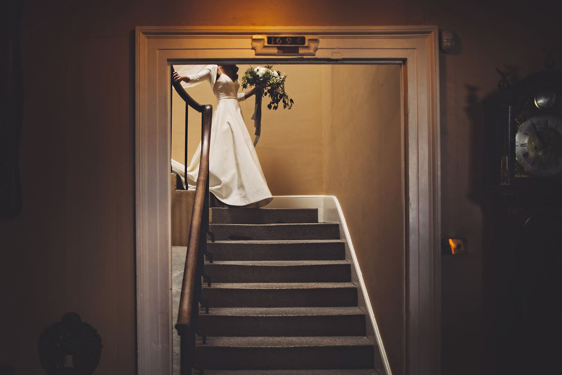 view of a brides dress walking downstairs