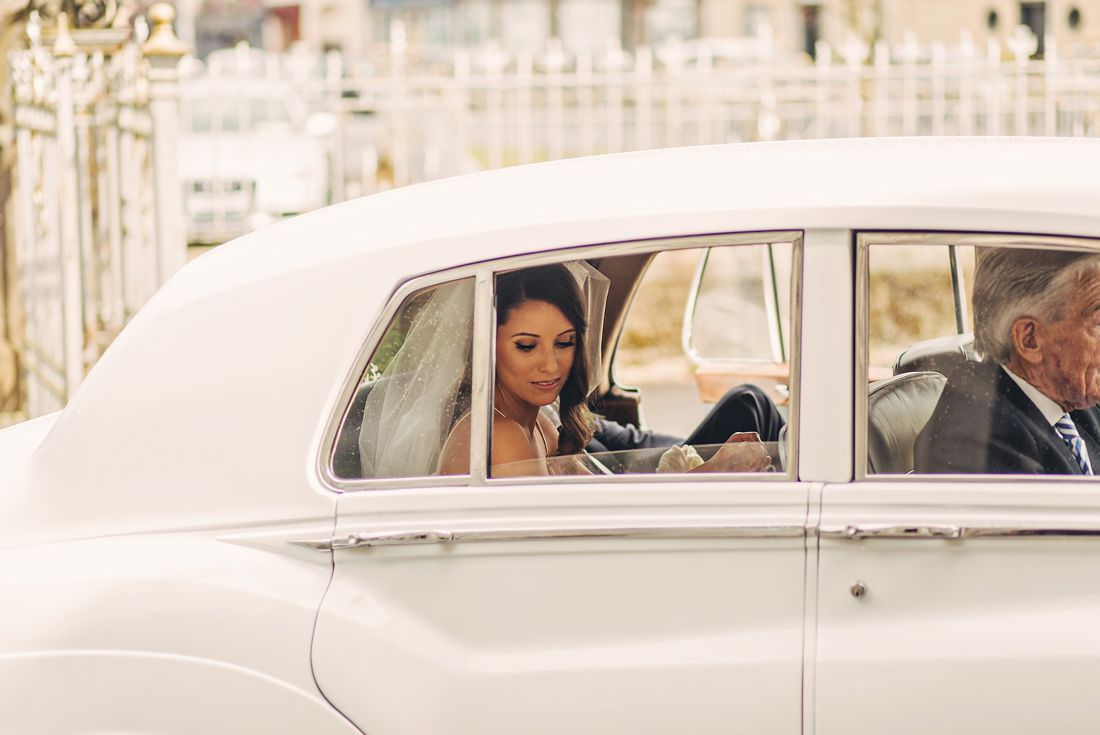 Bride in a car looking out the window