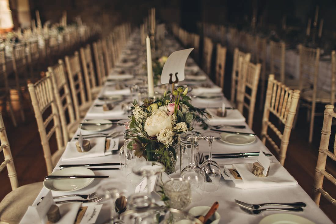 a table set with flowers and cutlery at a wedding venue in ireland