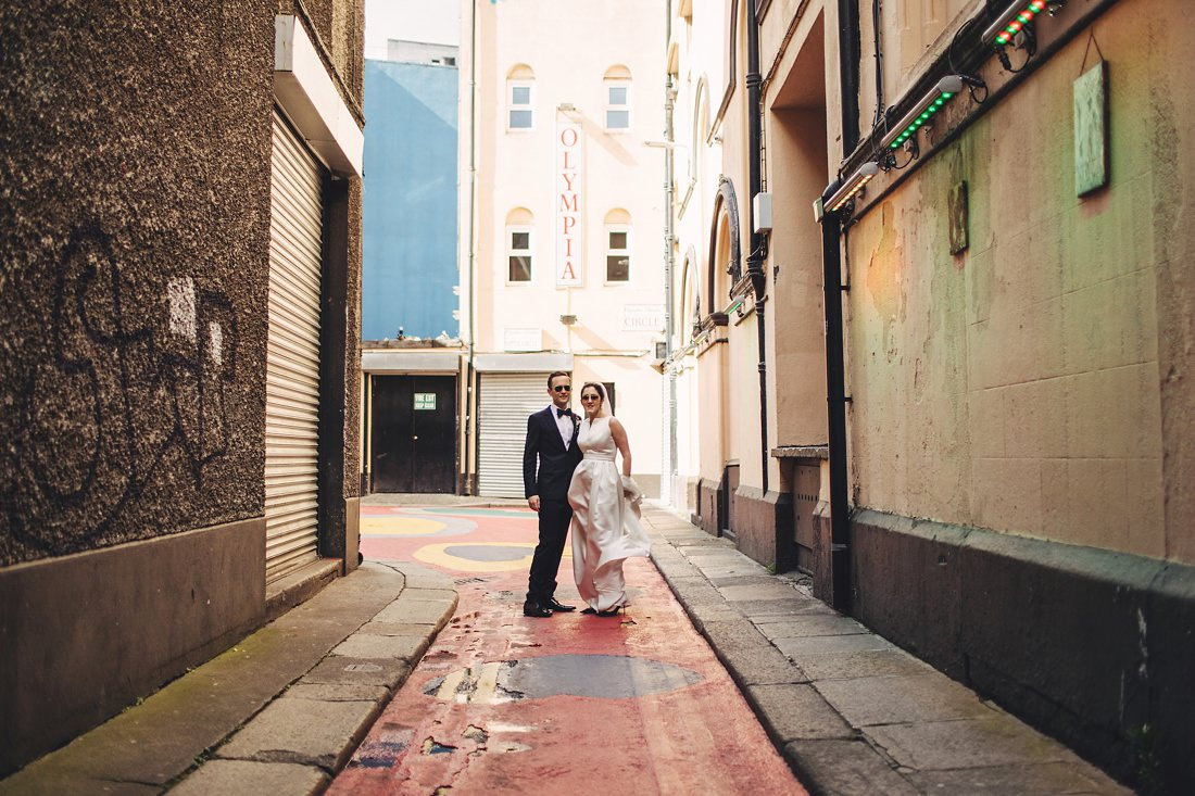 Dublin City Wedding Photography with a bride and groom in a lane