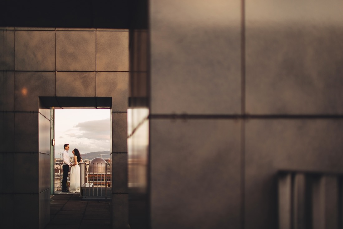 bride and groom on the hotel roof at sunset