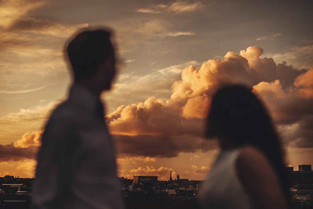 Amazing clouds in the background of a bride and groom silhouette