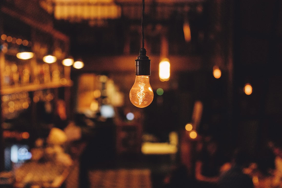 A light bulb in a restaurant in the evening