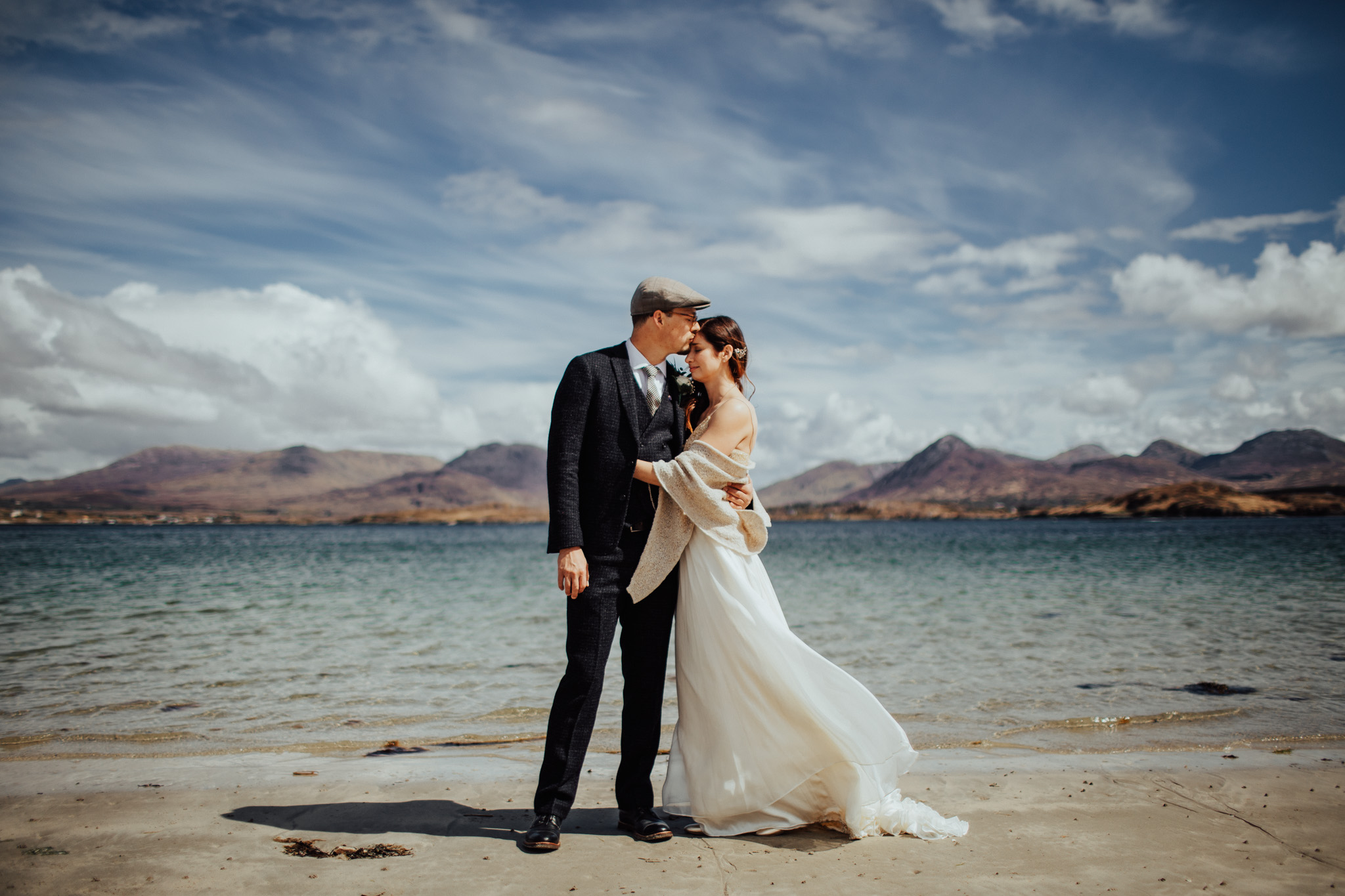 A couple posing for their Wedding Photography on the beach in Connemara