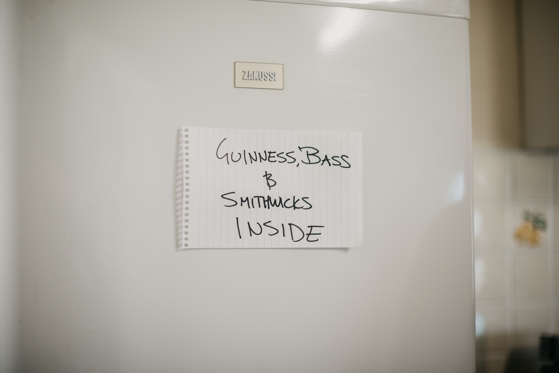 A sign on a fridge