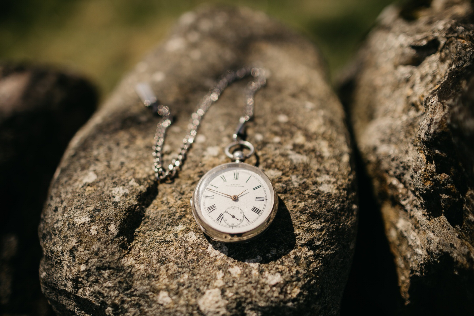 A pocket watch on a rock