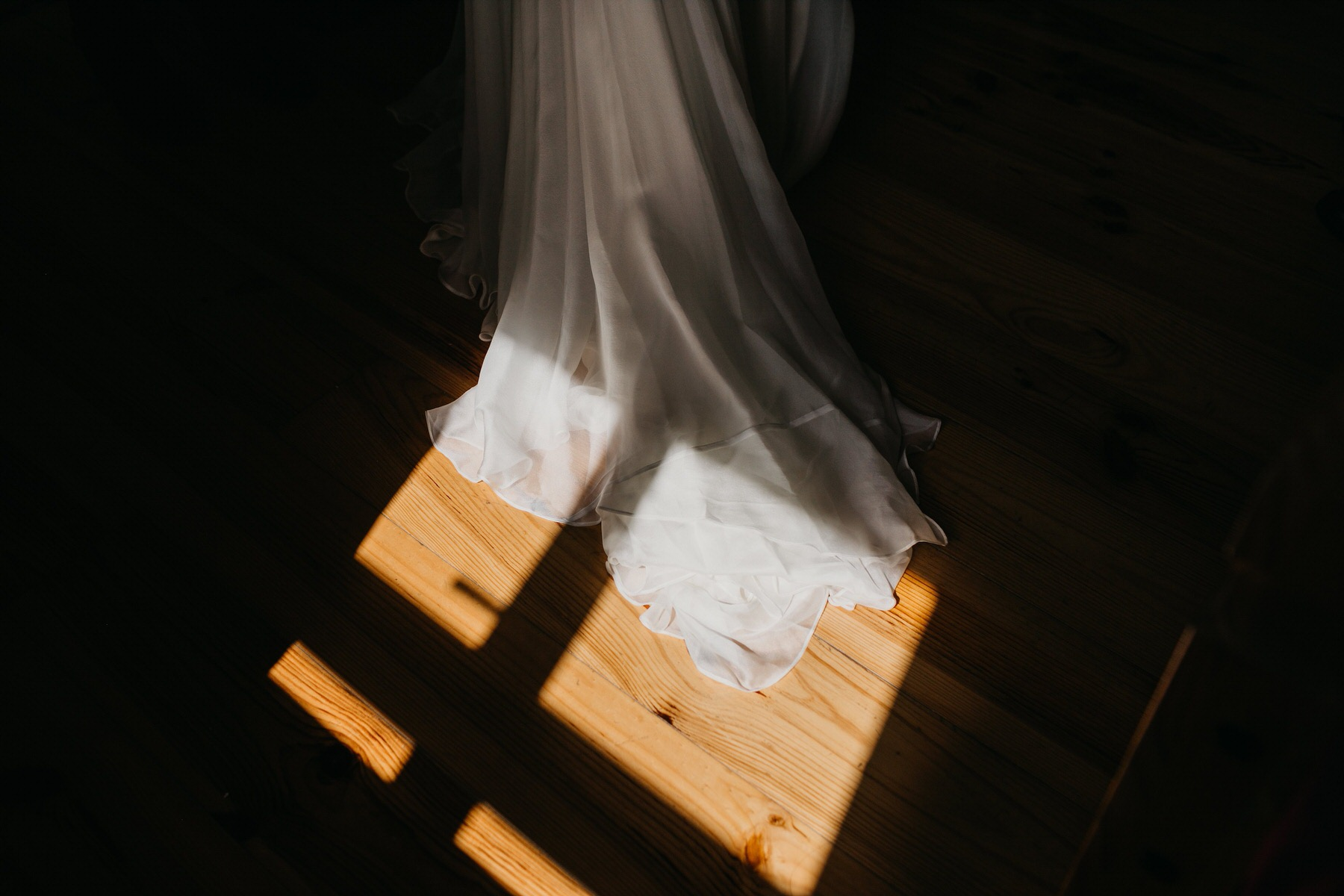 Wedding dress in the light from the window