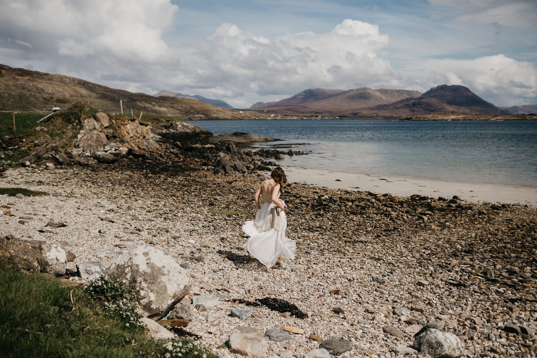 Bride walking on the beach in Connemara