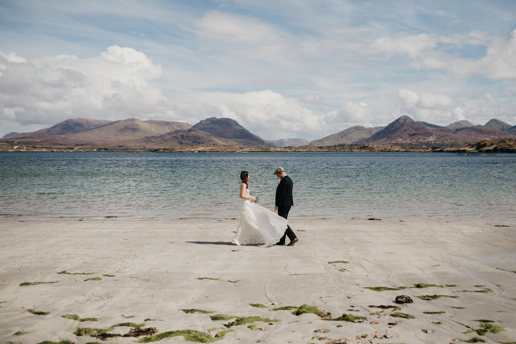 A bride and Groom meeting on a beach for the first look
