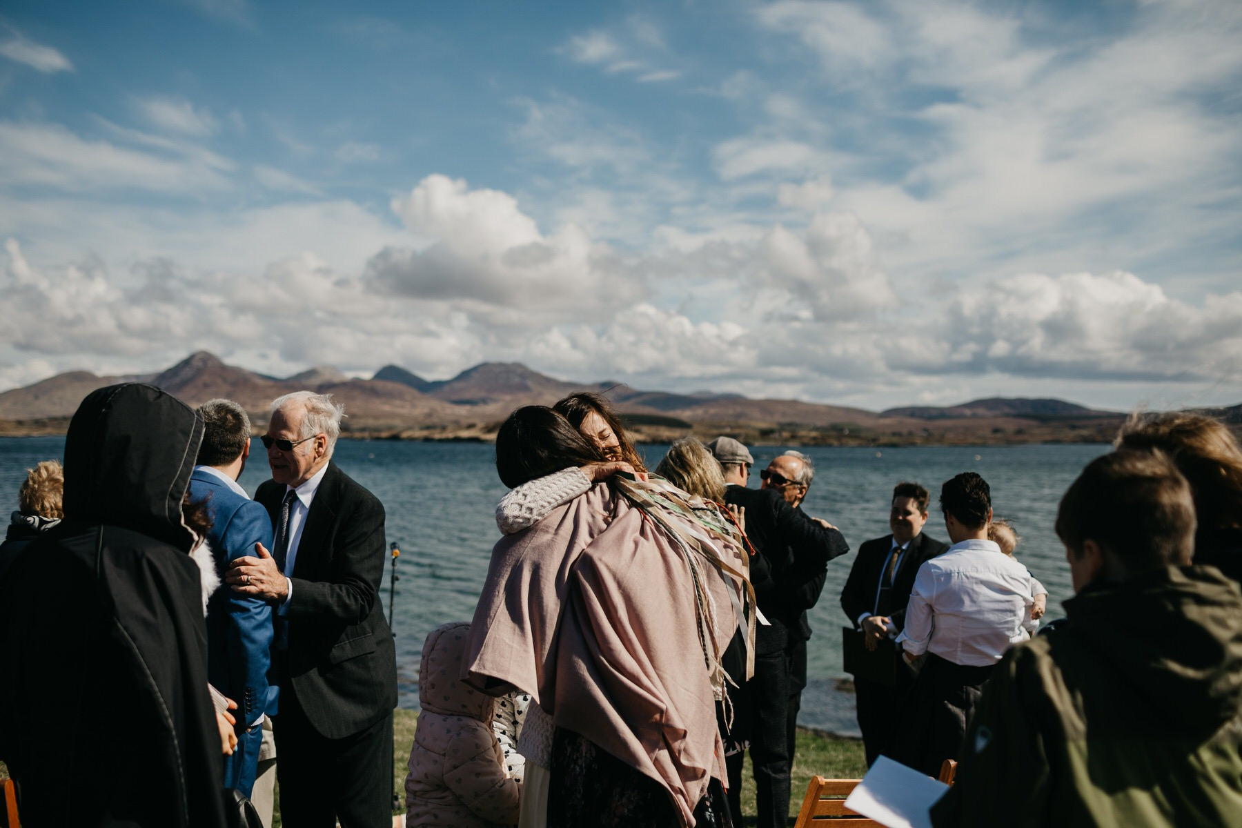 Bride hugging a guest at her wedding in Connemara