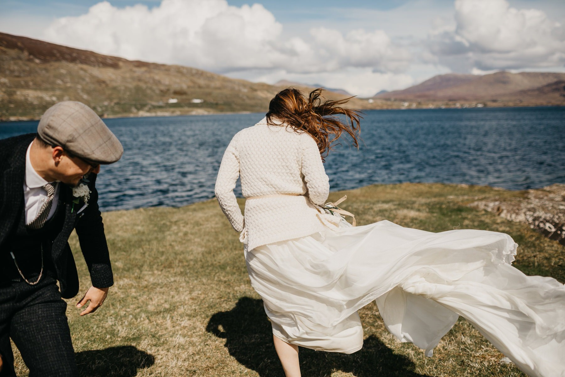 bride walking in the wind and her dress is blowing