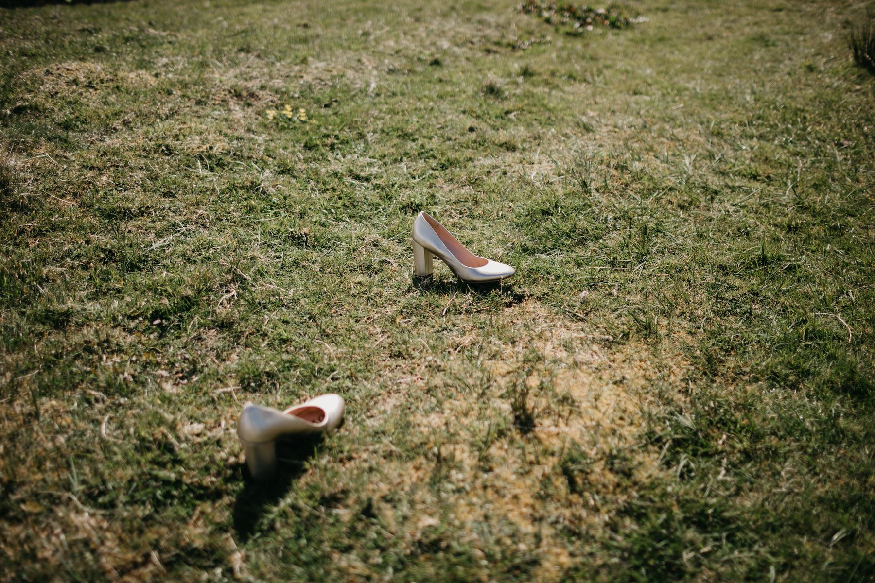 Bride shoes on the grass