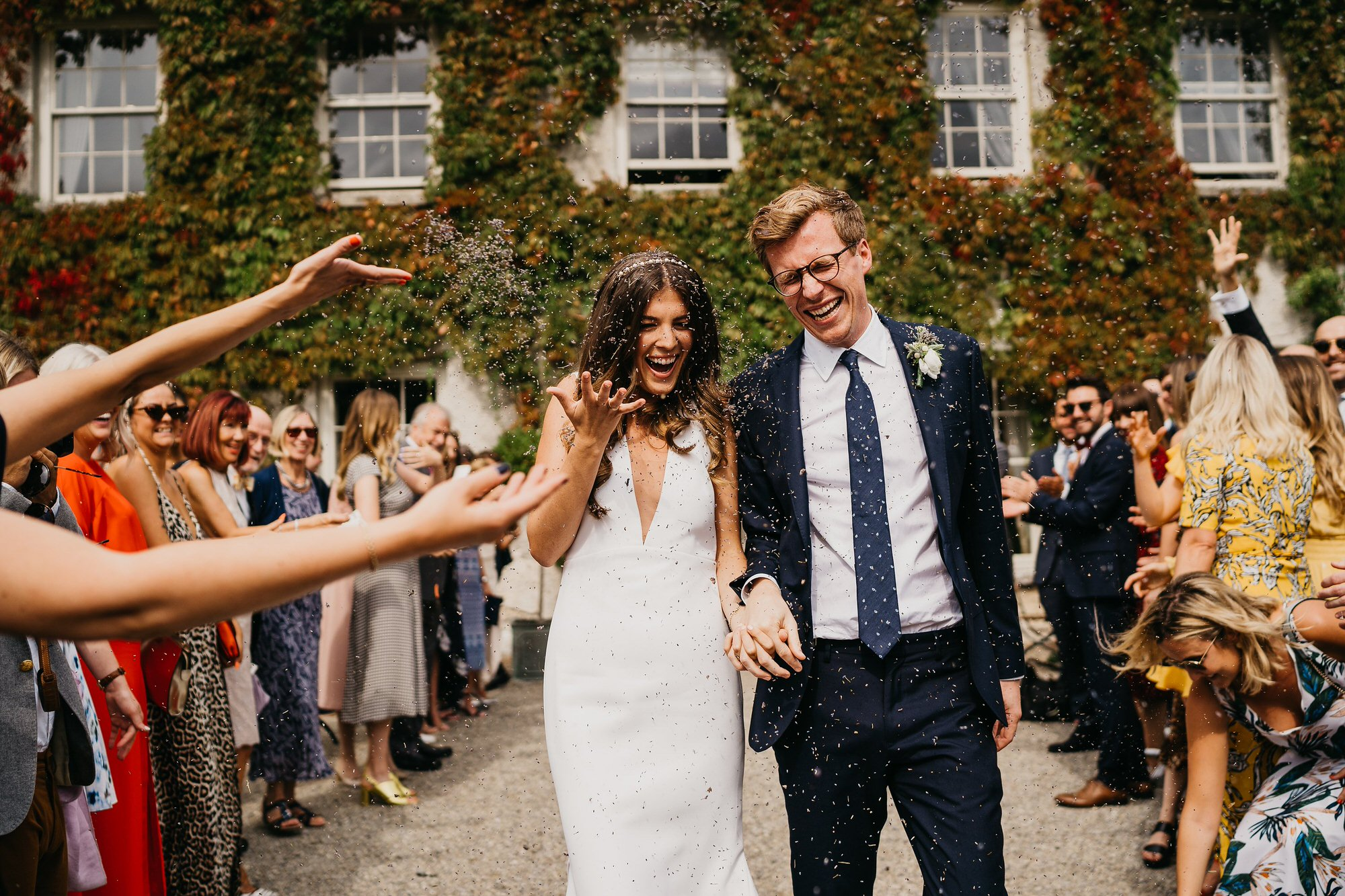 Bride and Groom at Cloughjordan house with confetti throwing