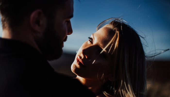 Beautiful light on a girl looking at a guy