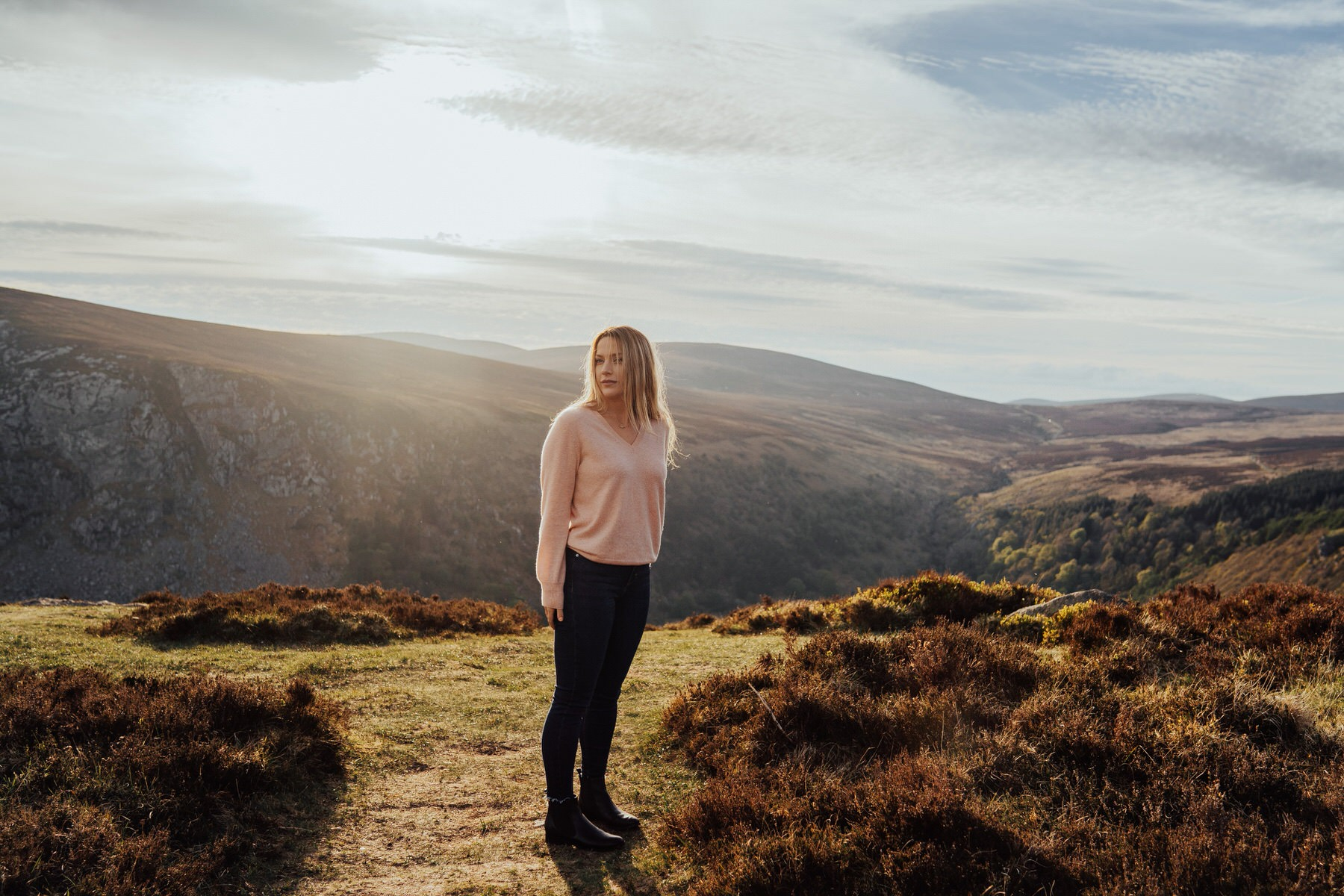 A girl standing on a mountain