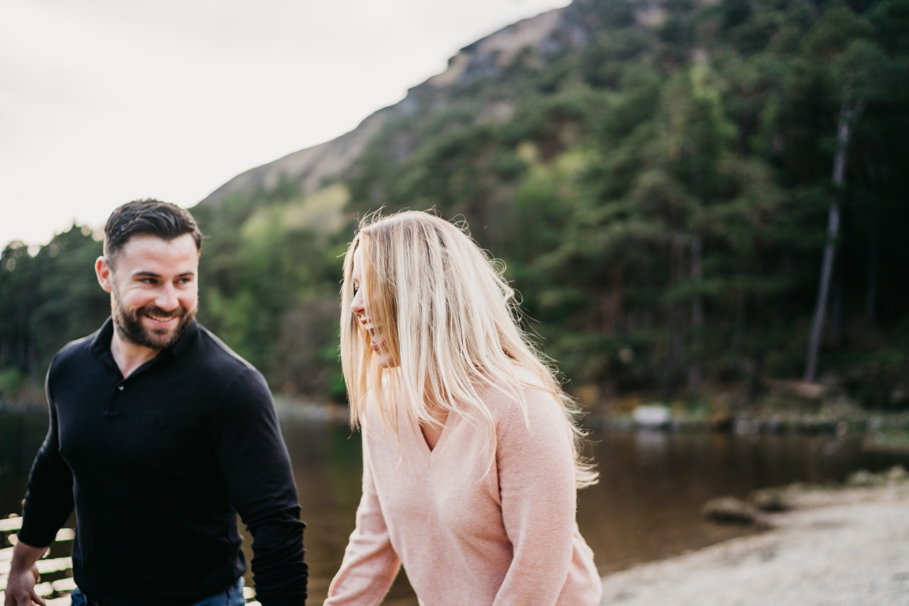A couple laughing during an engagement shoot